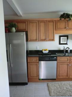 Remodeled Kitchen with new cabinets, appliances and tile floors by Compton Contracting
